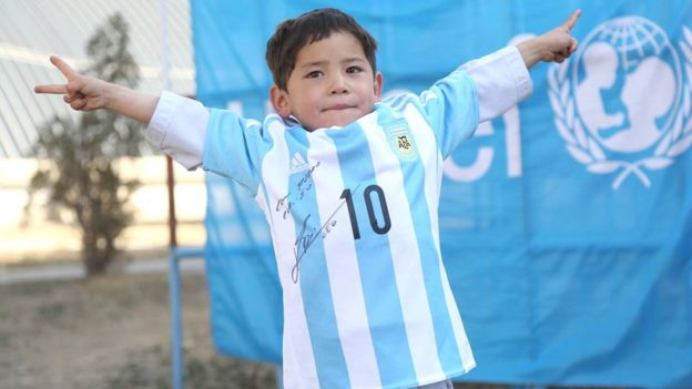Murtaza and his signed Messi shirt