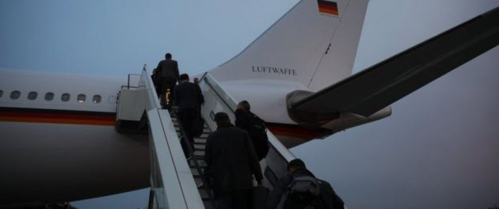 People board a Airbus A340 that stands at Berlin Tegel airport in Berlin. Monday March 13, 2017