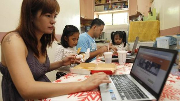 English-speaking workers in Manila take on outsourced work at home