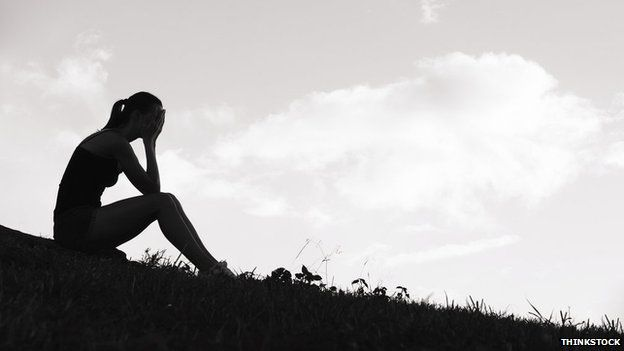 Unhappy teenage girl in silhouette