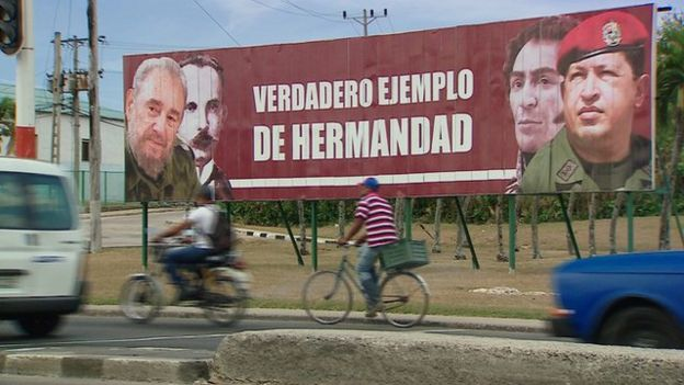 Billboard that shows a picture of Castro and Chavez