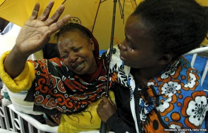 A woman sees her son who was rescued from the Garissa University attack in Kenya