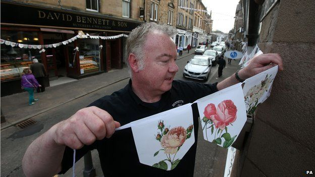 Graham Fleming puts up bunting in Dunblane
