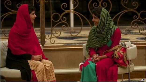 Malala Yousafzai (left) and Shazia Ramzan chat after meeting for the first time after the attack