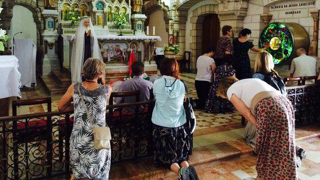 Pilgrims pray in chapel dedicated to Mariam Bawardy