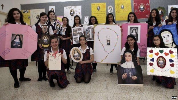 "Students of the Rosary Sisters girls"" secondary school in Jerusalem""s northern neighborhood of Beit Hanina pose with portraits of Sister Marie Alphonsine Ghattas, on May 12, 2015"