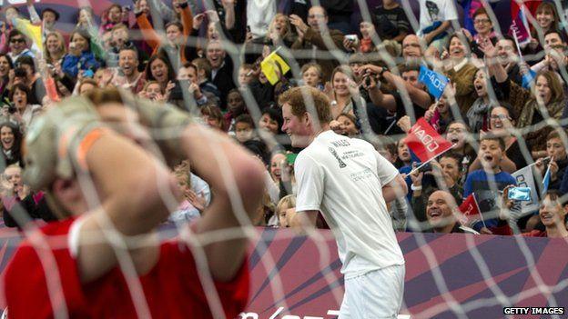 Prince Harry celebrates scoring the winning goal