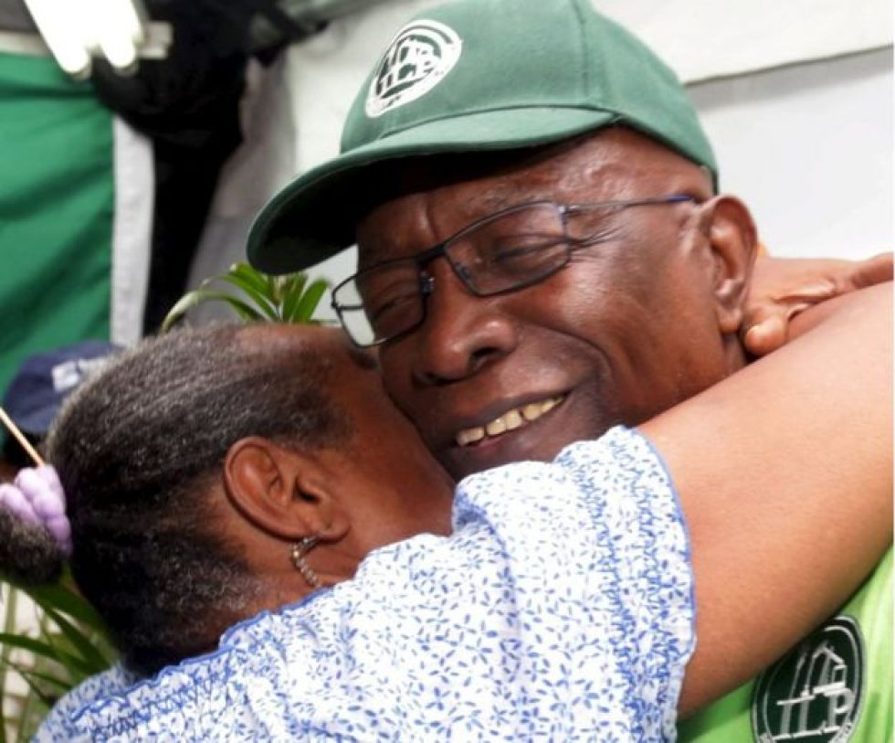 Jack Warner hugs a supporter