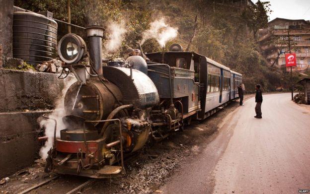 Darjeeling Himalayan Mountain Railway steam train taking on water
