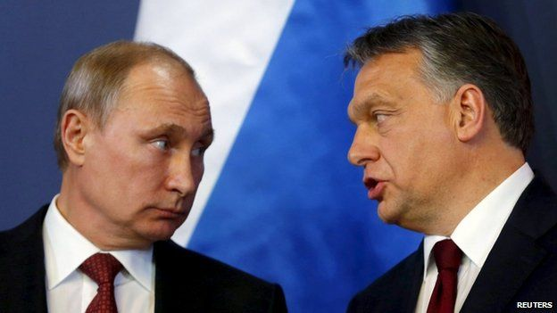 Russian President Vladimir Putin (left) listens to Hungarian Prime Minister Viktor Orban before a joint news conference in Budapest in February 2015