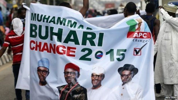 All Progressives Congress (APC) supporters hold a banner with a photograph of former military ruler Muhammadu Buhari before a convention to select a candidate to take on President Goodluck Jonathan, in Lagos, Nigeria - 10 December 2014