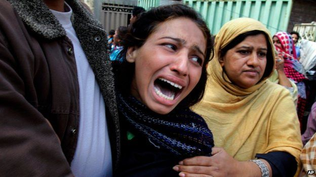 A woman mourns a family member killed in a suicide bombing