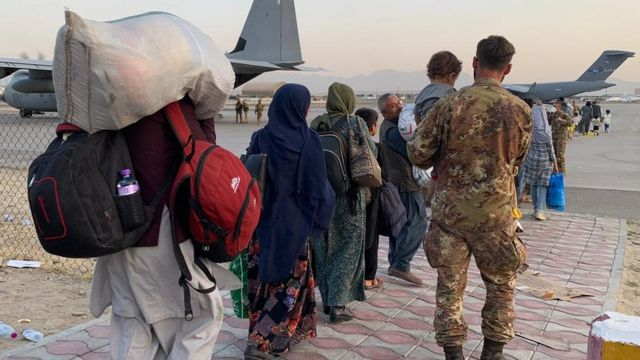 People walking towards planes at Kabul airport