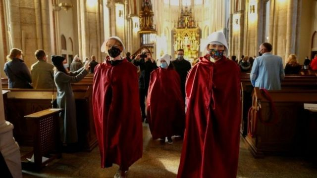 Demonstrators inside a church in Poland protest against abortion laws