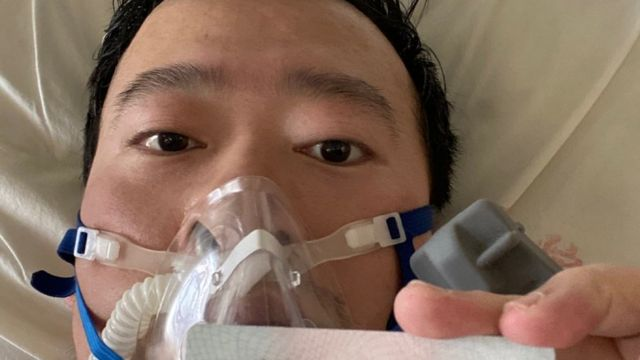 Dr Li shares a picture of himself in a mask from his hospital bed in Wuhan on Friday