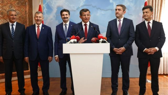Former Turkish Prime Minister Ahmet Davutoglu (fourth from the left) held a press conference in his office in Ankara on September 13, 2019, to announce that he would launch