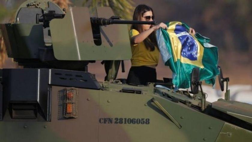 Woman on top of tank at pro-Bolsonaro demonstration