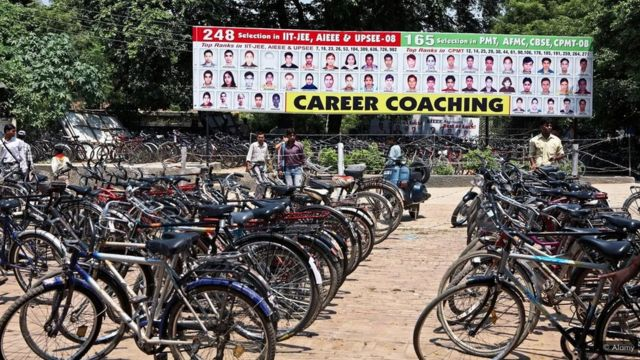 A busy training center for students in Lucknow displays photos of its former students who have achieved professional successes