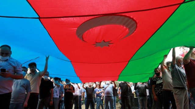 People carrying a huge flag of Azerbaijan