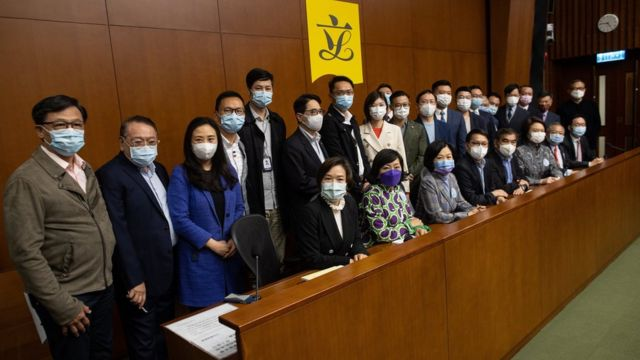 Pro-Beijing lawmakers attend a press conference at the Legislative Council in Hong Kong, China, 11 March 2021.