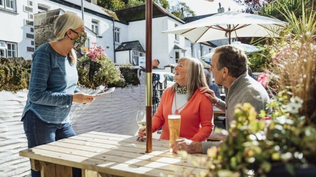 A couple ordering drinks in the beer garden (profile photo)
