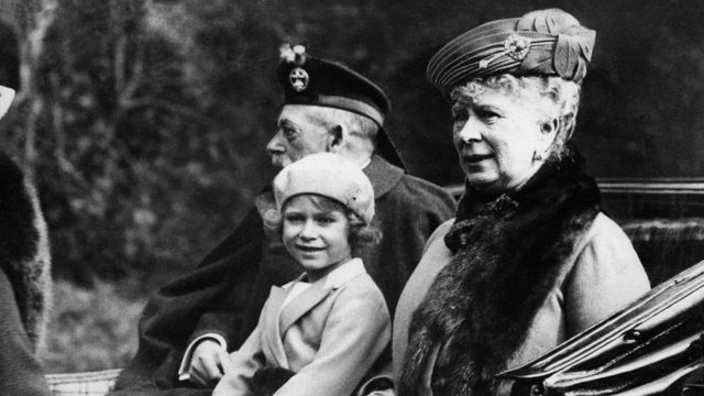 Queen Elizabeth as a child in 1932 with her grandfather, King George V