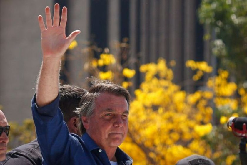 Jair Bolsonaro waves to supporters during a September 7 protest in Brasília