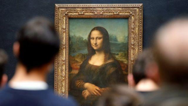 Visitors admire Leonardo da Vinci's Mona Lisa at the Louvre Museum in Paris. May 2021