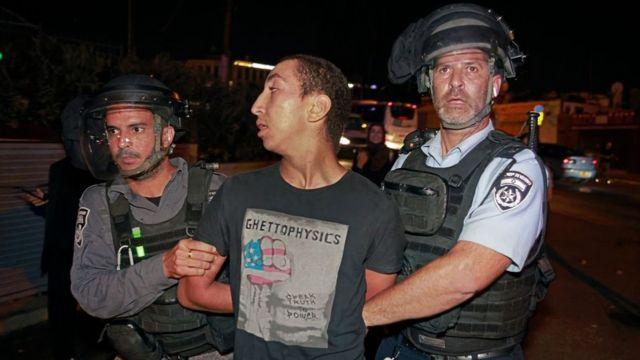 Israeli security forces arrest a demonstrator during a Palestinian demonstration against the evacuation of the Sheikh Jarrah neighborhood in East Jerusalem