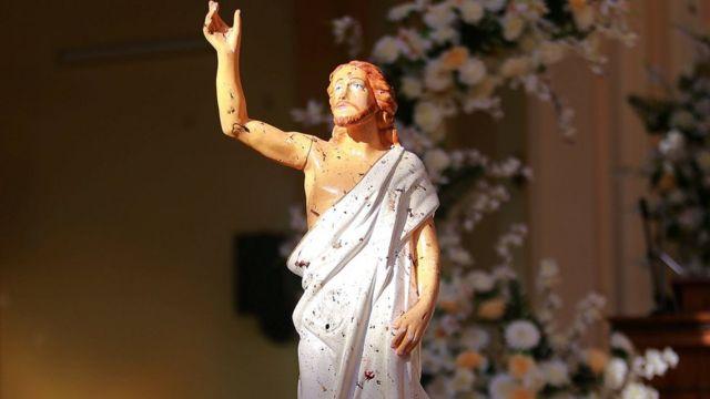 Blood-splattered Jesus statue in a church in Negombo