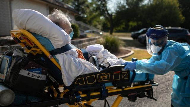 An Austin-Travis County medic loads a patient with COVID-19 symptoms into an ambulance on August 05, 2020 in Austin, Texas