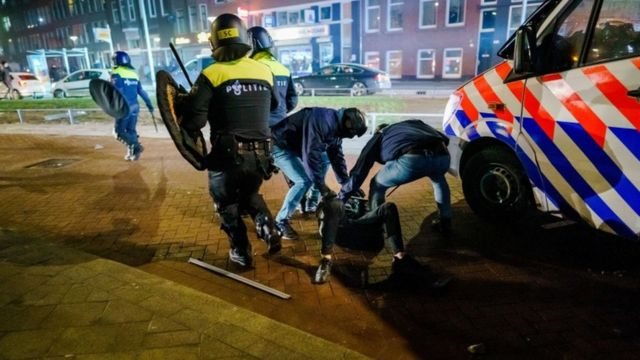 Police arrest a rioter