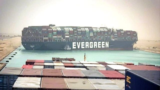 The container tanker Evergiven, operated by Taiwan's Evergreen Corporation, is blocking the Suez Canal by accident.