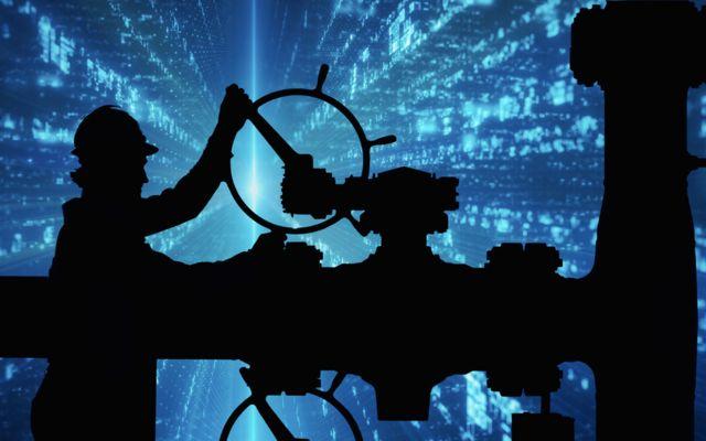 사이버 그래픽 배경 앞의 석유 노동자