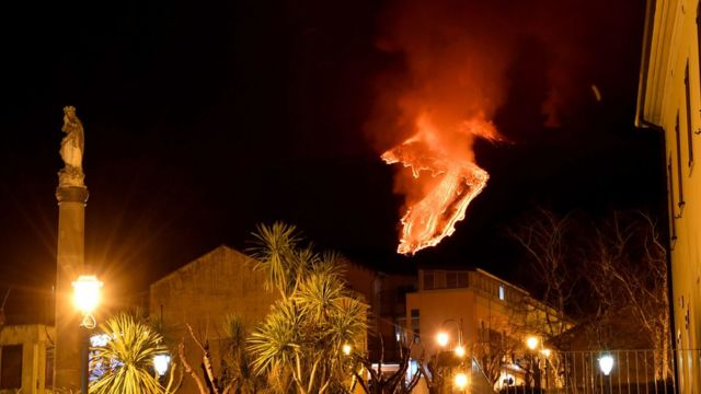 Mount Etna eruption seen from nearby town