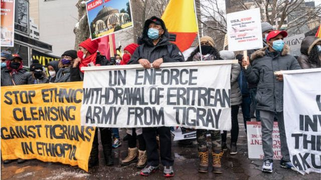 Protesters in New York hold a banner demanding the withdrawal of Eritrean forces from Tigray