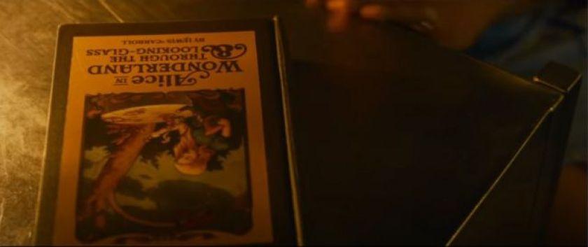 "Scene from The Matrix Resurrections shows book ""Alice in Wonderland"""