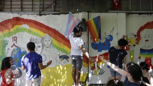 Activists paint rainbow murals before the annual march