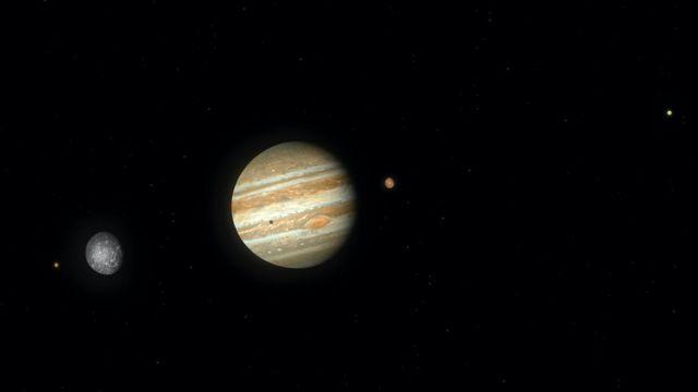 Ilustração de Júpiter no breu, com algumas luas em volta