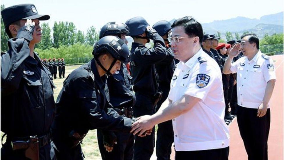 孙力军(身穿白色警服)在山东出席活动的资料照片。