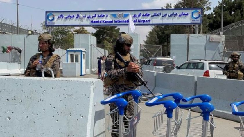 Taliban forces stand guard at the entrance to Hamid Karzai International Airport in Kabul, 31 August 2021
