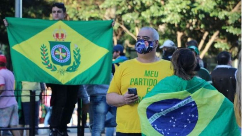 Protester holds flag of Brazil Empire in protest on Avenida Paulista, in São Paulo