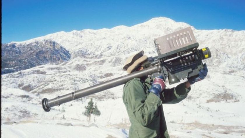 Afghan guerrilla with missile launch unit