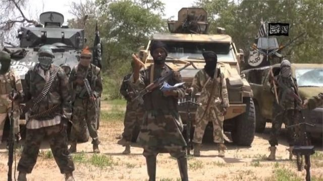 Militants from Boko Haram raise the banner of ISIS
