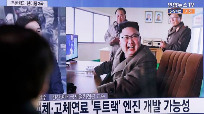 "A man watches a TV news program showing an image, published in North Korea""s Rodong Sinmun newspaper, of North Korean leader Kim Jong Un at the country""s Sohae launch site, at Seoul Railway station in Seoul, South Korea, Sunday, March 19, 2017"