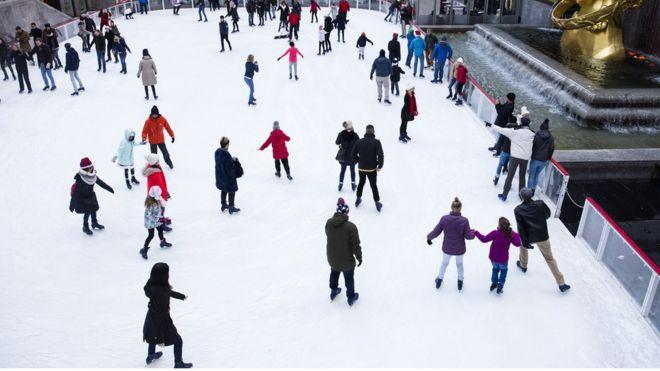People skate at the ice-skating rink at Rockefeller Center