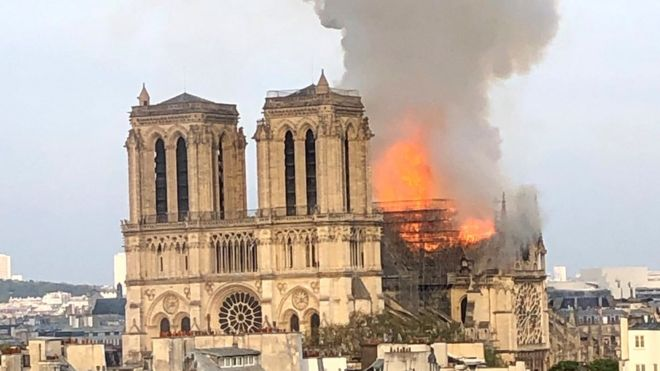 Flames billow from Notre Dame cathedral in Paris