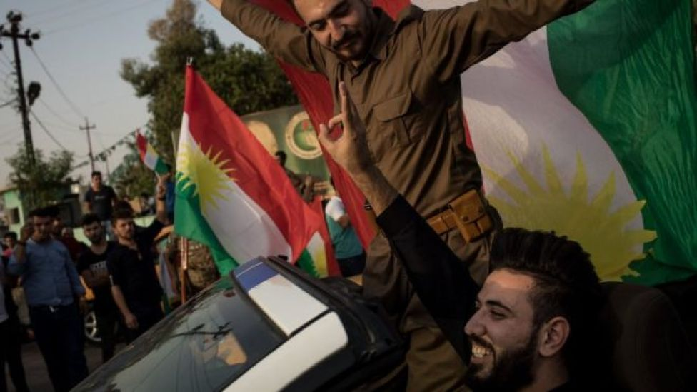 People celebrate on the streets after voting in a referendum on Kurdish independence in Kirkuk, Iraq (25 September 2017)