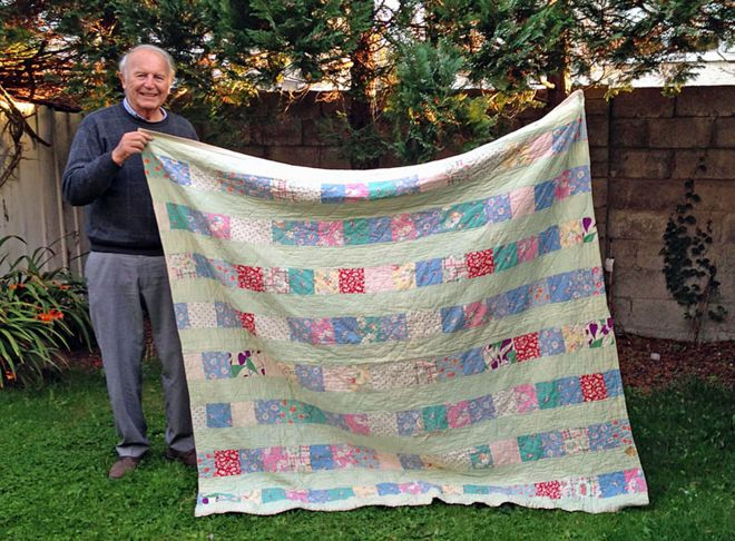 Joseph Briddock with his quilt