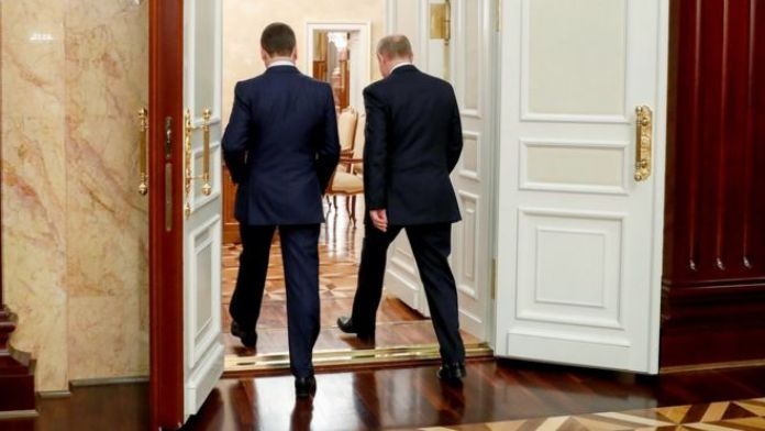 Russian President Vladimir Putin (R, back to camera) and Russian Prime Minister Dmitry Medvedev (L, back to camera) leave after a meeting with Cabinet members at Government headquarters in Moscow, Russia, 15 January 2020